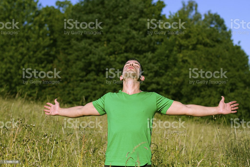 Carefree man standing in the golden field royalty-free stock photo
