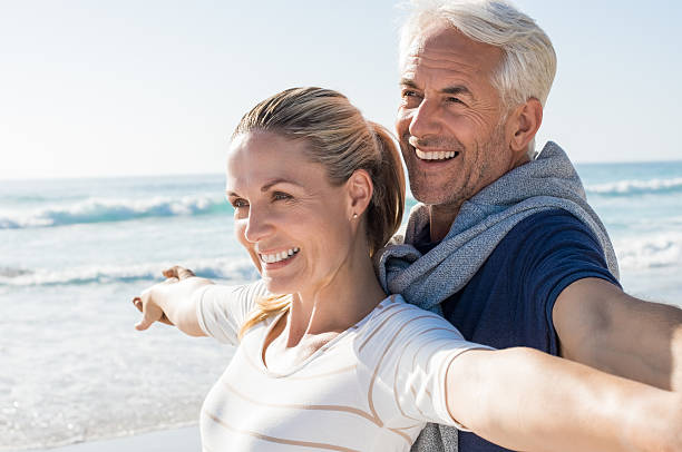 carefree mature couple - mid adult stock pictures, royalty-free photos & images