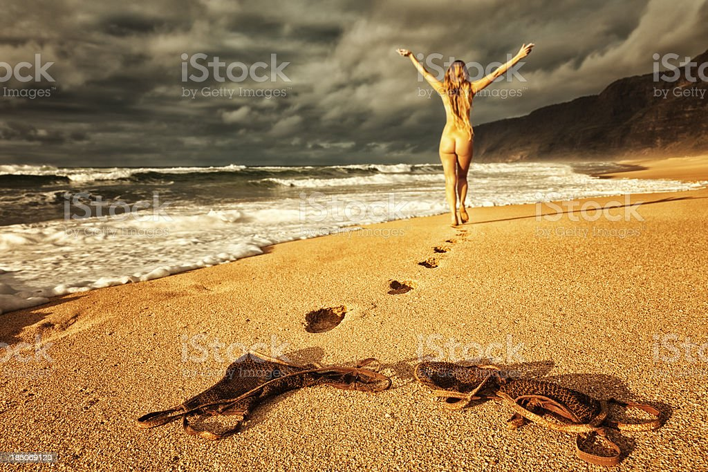 Carefree Nude Woman Walking On Beach At Sunset Stock Photo -5510