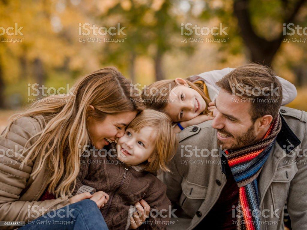 Carefree parents and their kids having fun at the park. zbiór zdjęć royalty-free