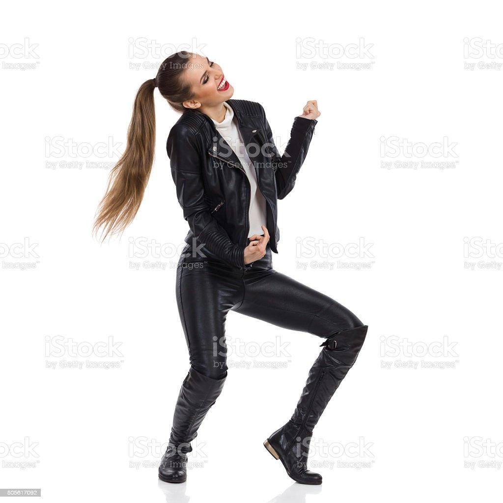Carefree Rock Girl Dancing stock photo