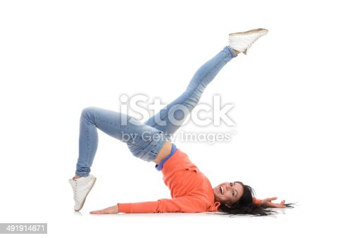 istock Carefree woman is laying down on the floor 491914671