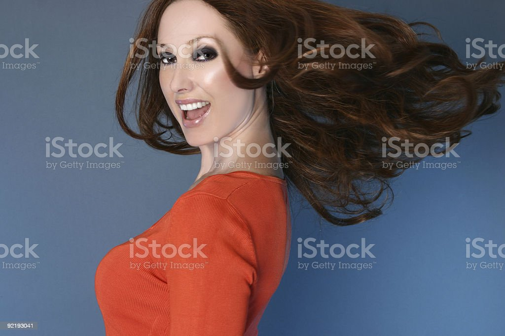 Carefree woman with long hair in motion royalty-free stock photo
