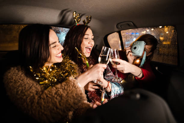 Carefree women celebrating New Year with the glass of champagne stock photo