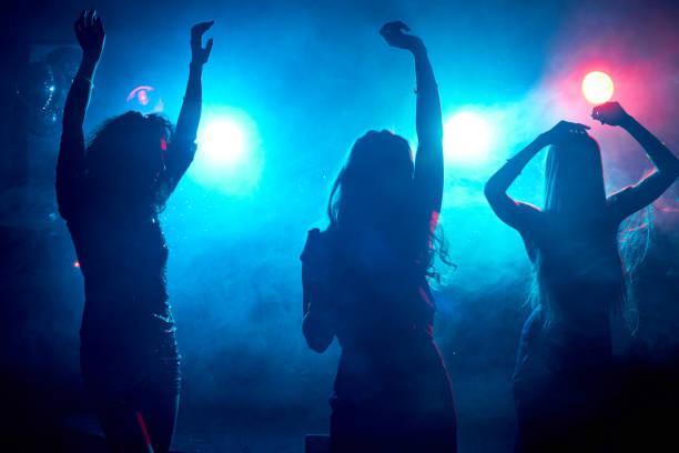 Carefree women dancing stock photo
