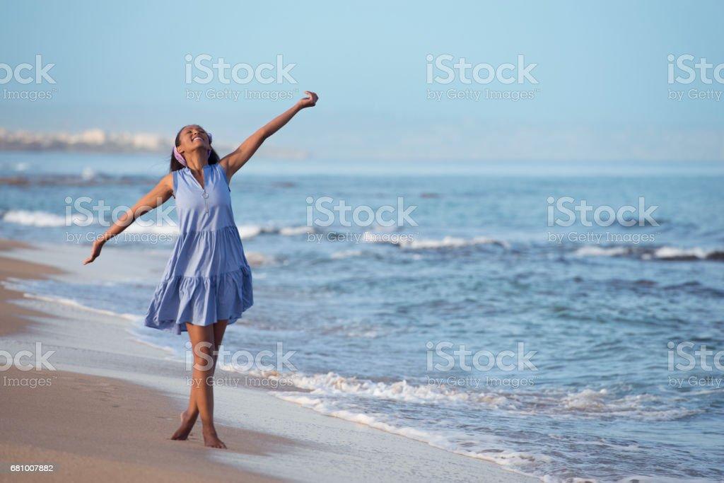Carefree women on seashore. royalty-free stock photo