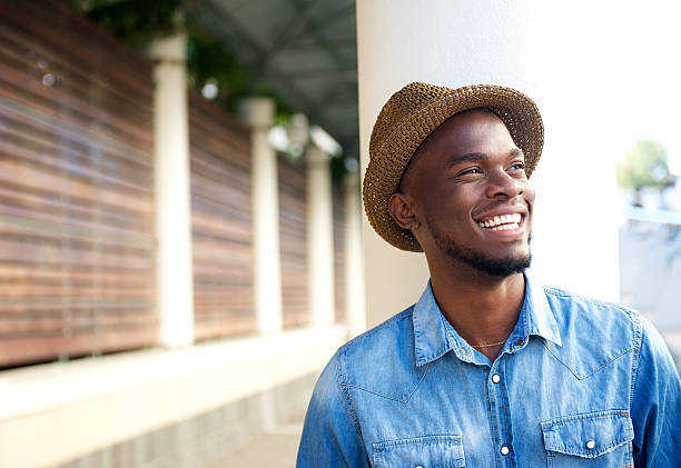 Carefree young african american man laughing stock photo