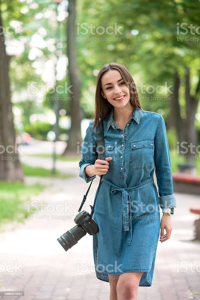 Carefree young girl wants to photograph nature royalty-free stock photo