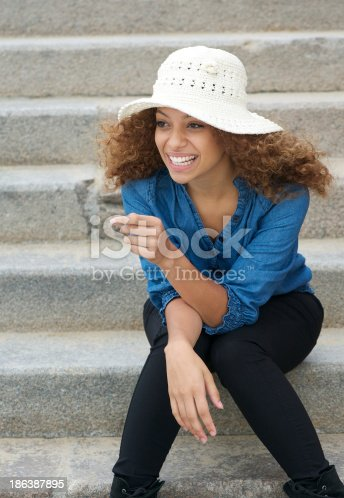 186534921 istock photo Carefree young woman laughing outdoors 186387895
