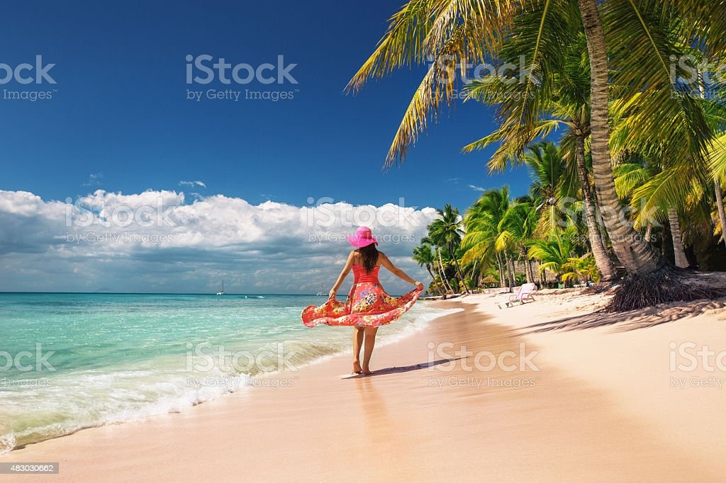 Carefree, Young woman relaxing on the islands beach stock photo