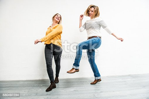 istock Carefree Young Women Jumping Indoors, Paris, France 530497234