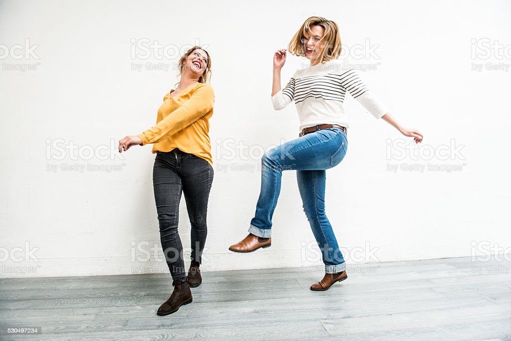 Carefree Young Women Jumping Indoors, Paris, France stock photo