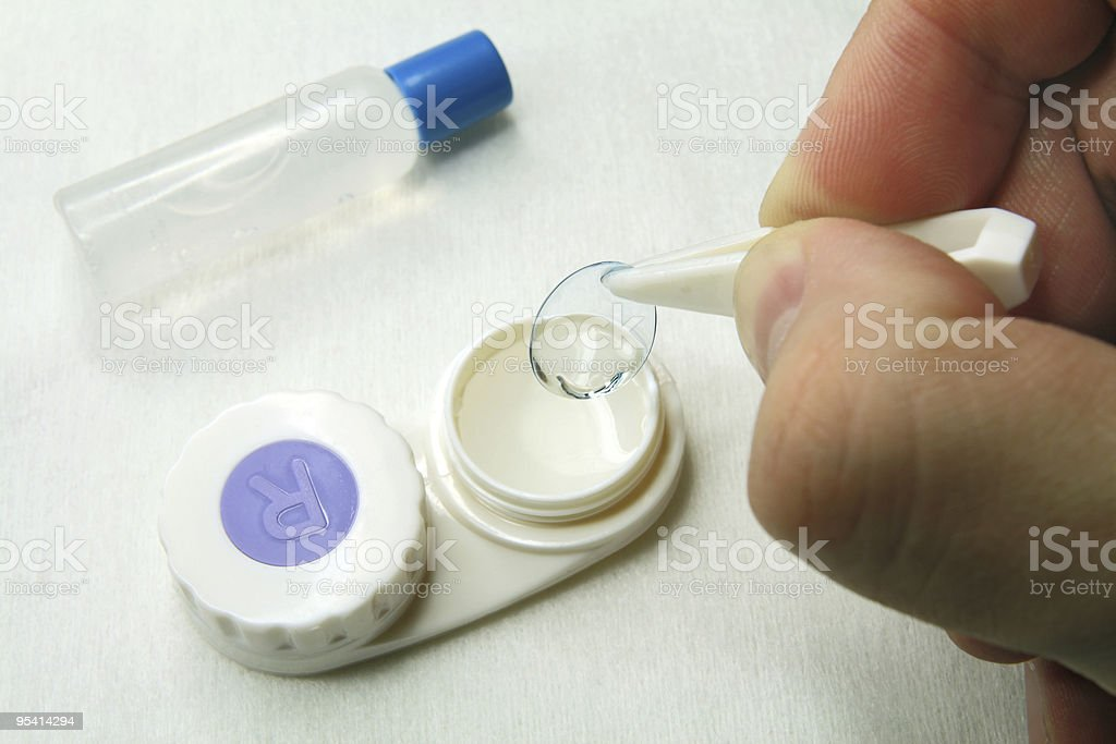 Careful handling of soft contact lenses stock photo