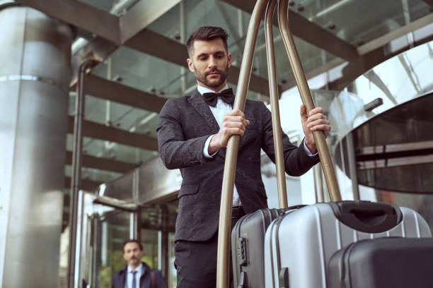 Careful managing of guests luggage is porters main duty stock photo