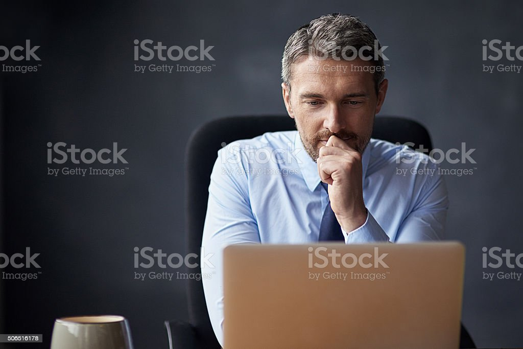 Carefully considering his next move stock photo