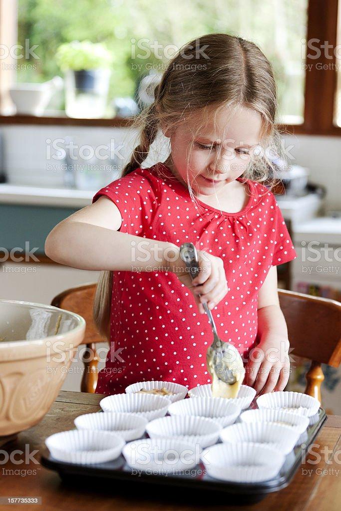 Carefully making cupcakes royalty-free stock photo