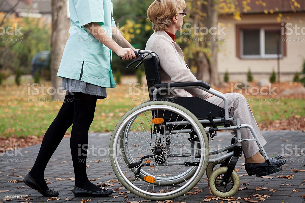 Caregiver and elder woman royalty-free stock photo
