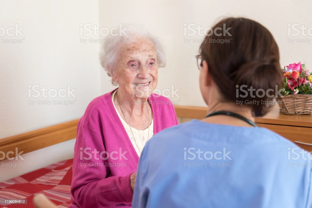 Caregiver and senior patient at nursing home