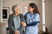 istock Caregiver assist senior woman at home 1296176562