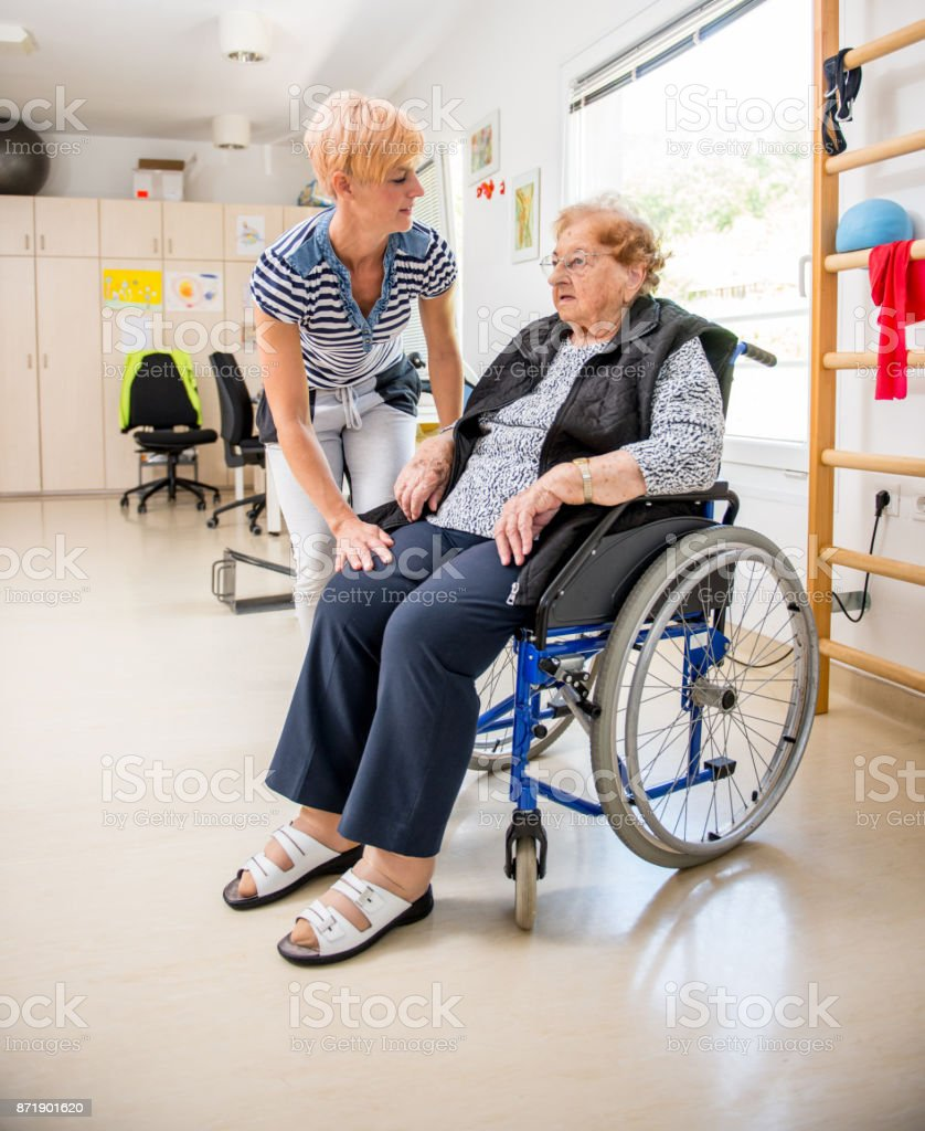 Caregiver Bonding With Senior Woman in Retirement Home.