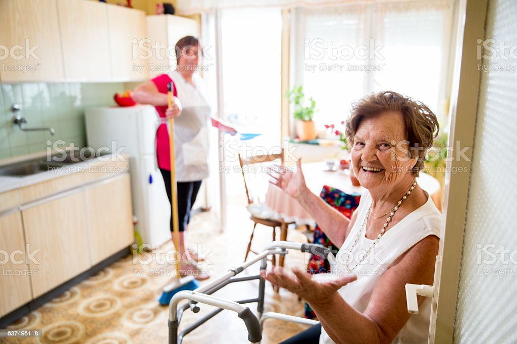 Caregiver Doing the Chores stock photo