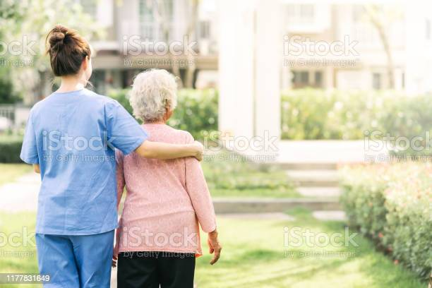 Caregiver walking with elderly woman outdoor picture id1177831649?b=1&k=6&m=1177831649&s=612x612&h=yhjjlyu c25p h1ihotcemc90yi1icyngrqgzcuool8=