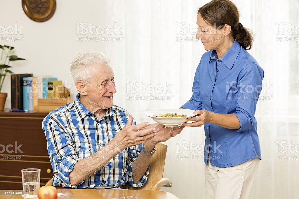 Caregiver with senior man royalty-free stock photo