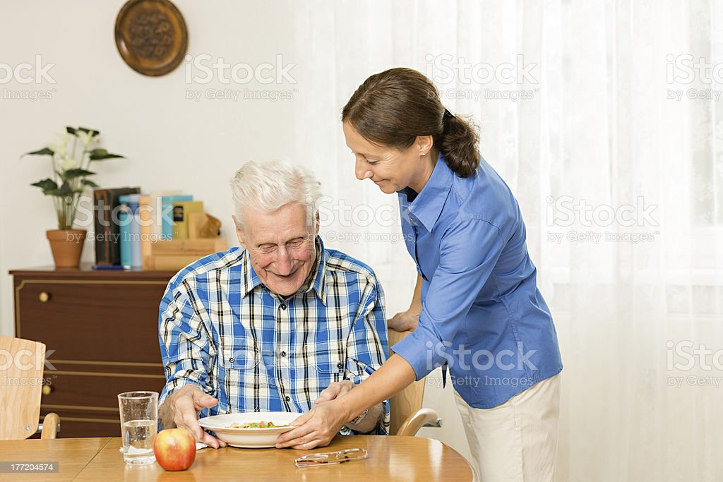 Caregiver with senior man royalty-free stock photo