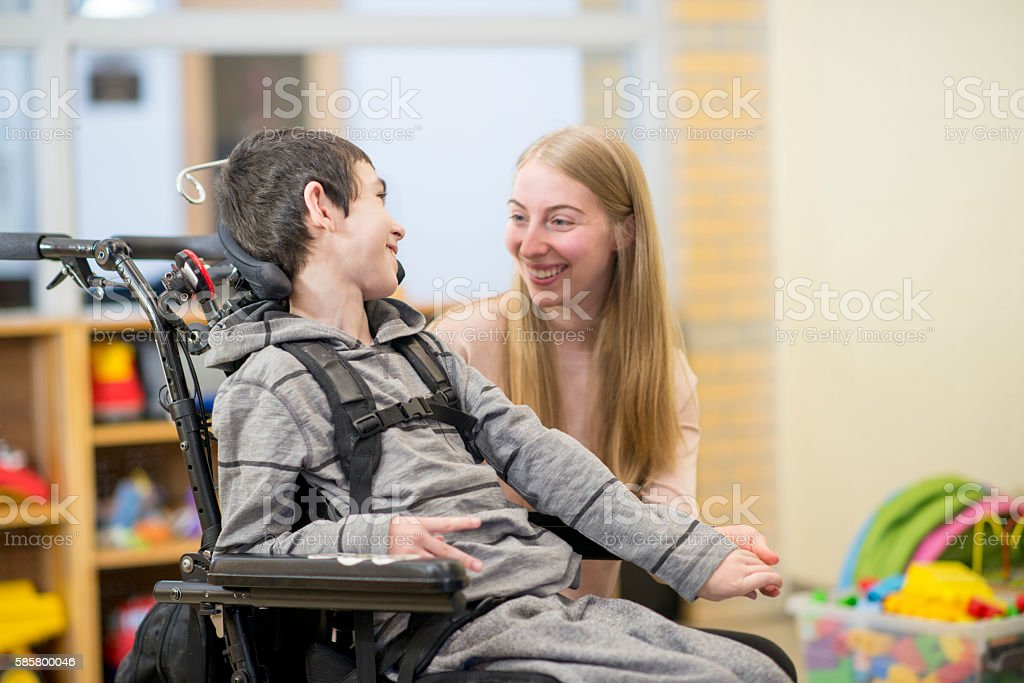 Caregiver Working with a Child stock photo