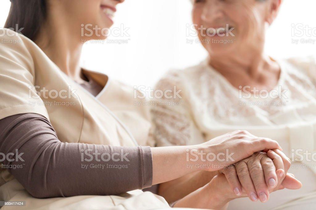 Caregiving in the nursing home stock photo