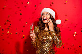 istock Careless, carefree concept. Lady with modern wave hairdro isolated on bright red background hold wine glass with alcohol beverage in hand look aside make big toothy smile 1060804302