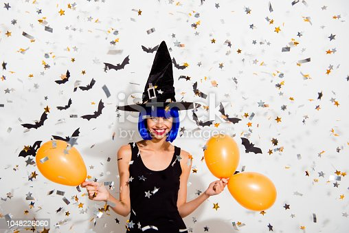 1016084100istockphoto Careless, carefree concept. Portrait of adorable, good-looking, alluring, magnificent lady hold orange helium blow balloon in hands make big toothy smile isolated on white background 1048226060