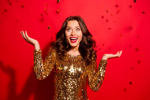 careless, carefree, dream, dreamy concept. photo of stylish, trendy modern lady with wave hairstyle isolated on bright red background raised hands up rest, relax on december night party - sukienka zdjęcia i obrazy z banku zdjęć