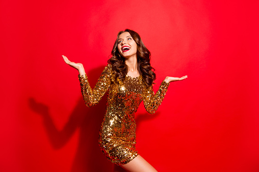 Careless, carefree, dream, dreamy concept. Portrait of stunning, adorable, good-looking lady with modern wave hairdro isolated on bright red background raised hands palms up make big toothy smile