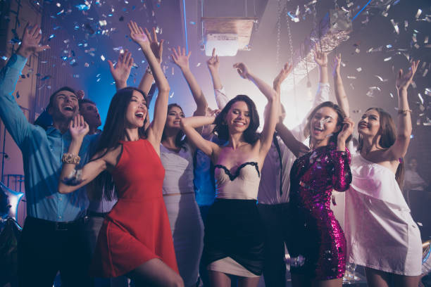 careless, carefree, dream, dreamy person dance on corporate, feast, festive raise hands up, close eyes, make big white toothy smile - prom stock photos and pictures