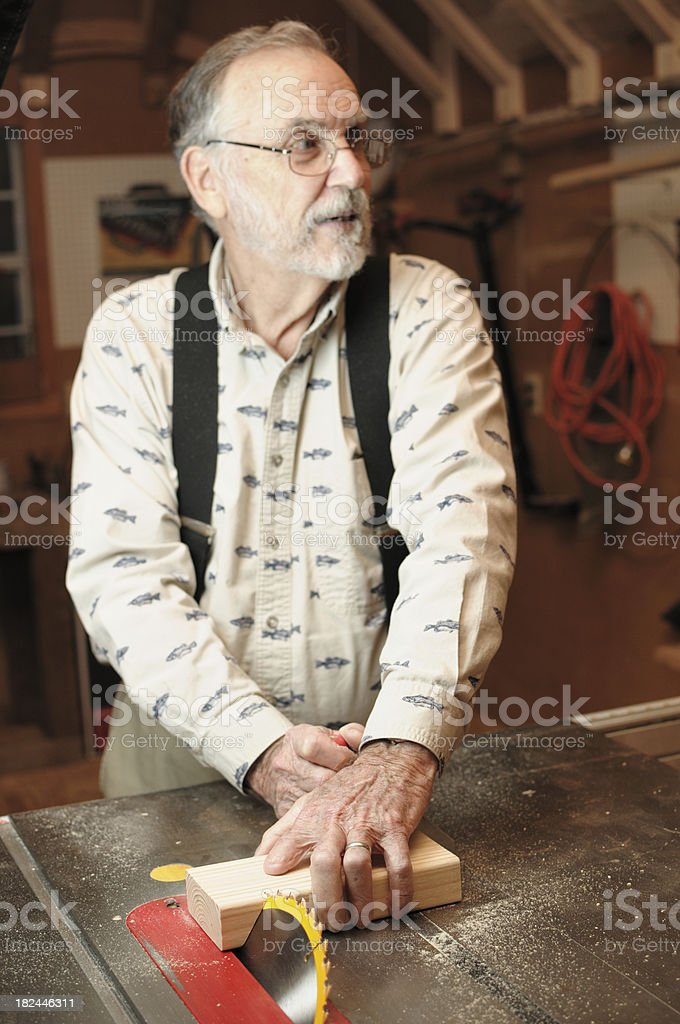 Careless use of table saw stock photo