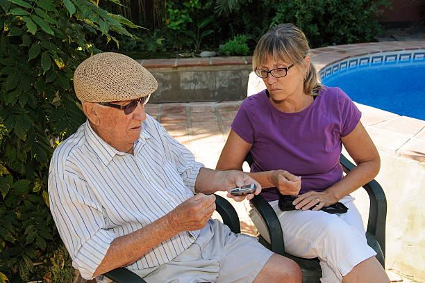 carer and elderly man stock photo