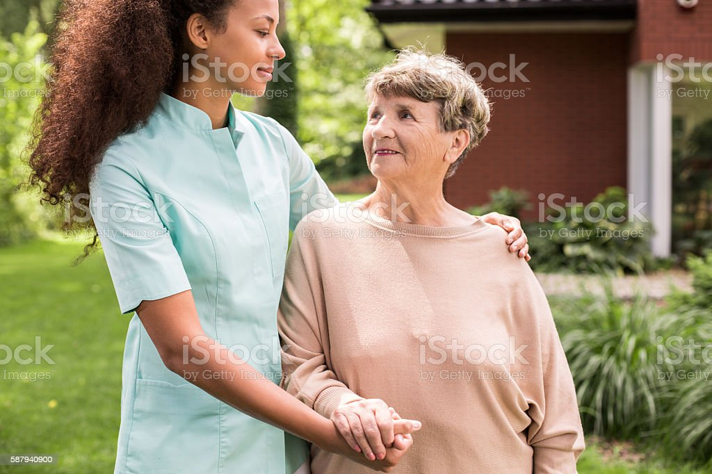 Carer and patient relaxing outdoor stock photo