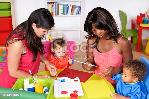 istock Carers And Babies/ Toddlers Doing Finger Painting 184089135