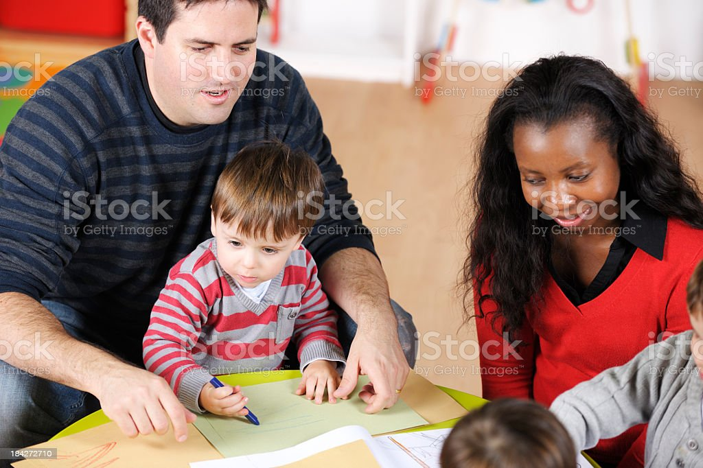 Carers Supervising Children Doing Artwork royalty-free stock photo