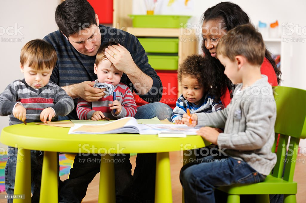 Carers Supervising Group Of Toddlers And Little Boy royalty-free stock photo
