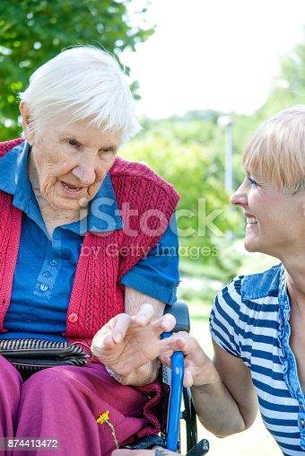 istock Caretaker In The Retirement Home Having Fun With Senior Woman 874413472
