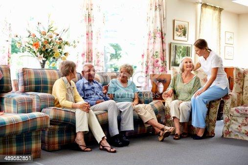 istock Caretaker with senior people in nursing home 489582851