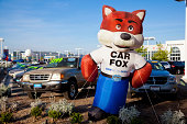 Sacramento, California - March 24, 2014: Inflatable Carfax mascot in front of Sacramento Chrysler Dodge Jeep RAM car dealership on Fulton Avenue. Carfax is web-based service that supplies vehicle history reports to individuals and businesses for the USA and Canada markets.