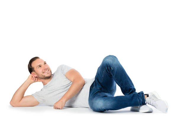 carfree man laying on the floor, thinking. - reclining stock photos and pictures