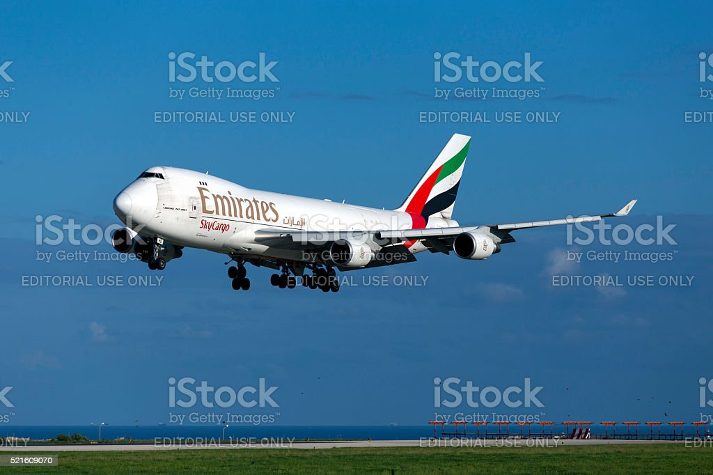 Cargo 747 landing in sunny weather stock photo