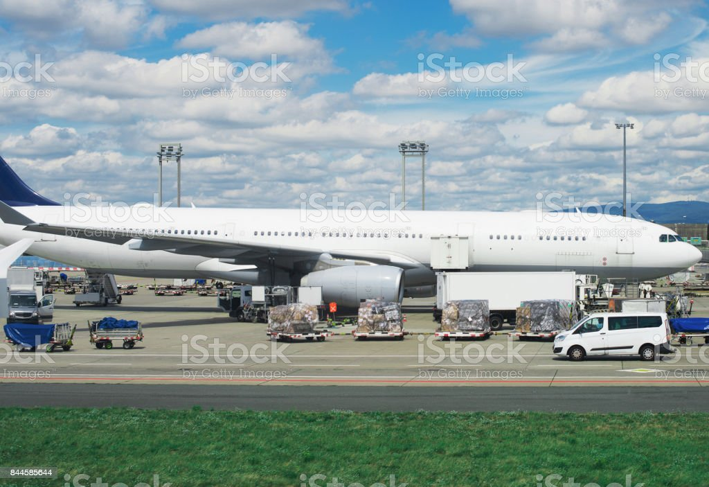 Cargo aircraft is loading at the airport. stock photo