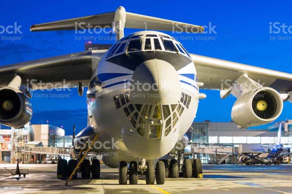 Cargo airplane at the airport apron in the night стоковое фото