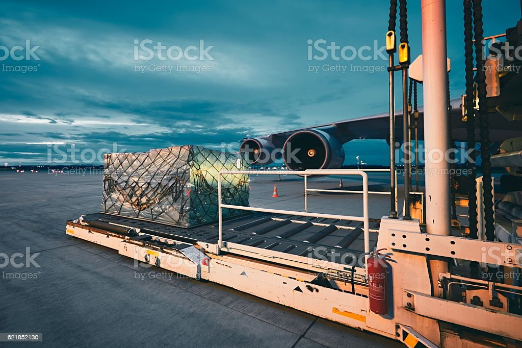 Cargo airplane at the dusk stock photo