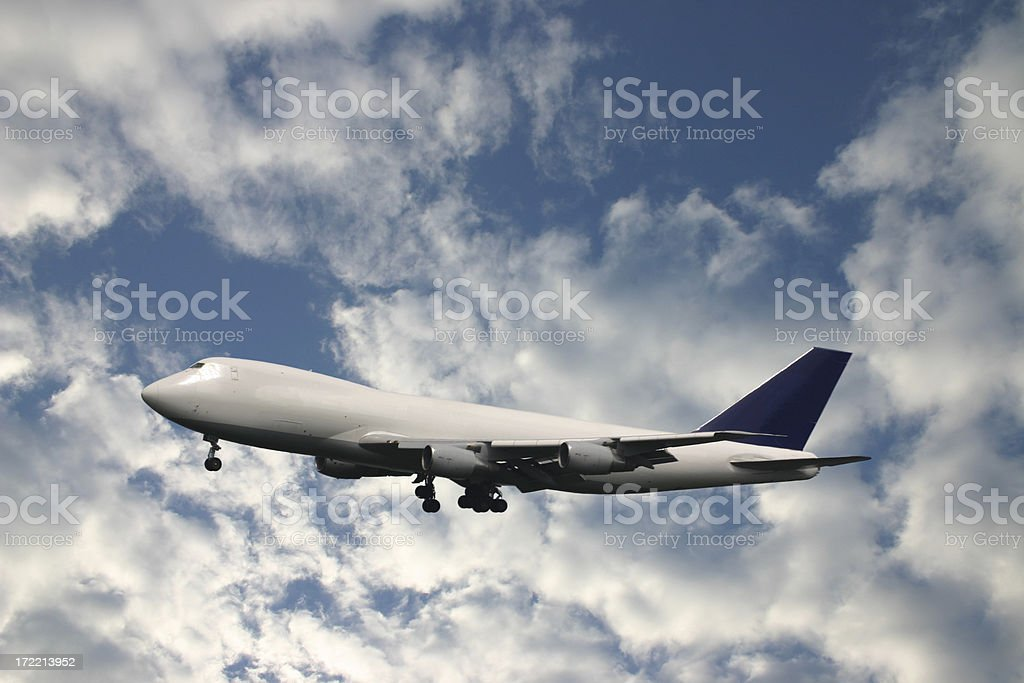 Cargo airplane in front of blue cloudy sky royalty-free stock photo